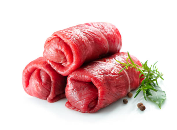 Raw beef roulades isolated on white stock photo