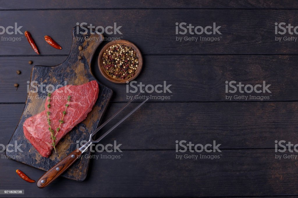 Raw beef steak and fork stock photo