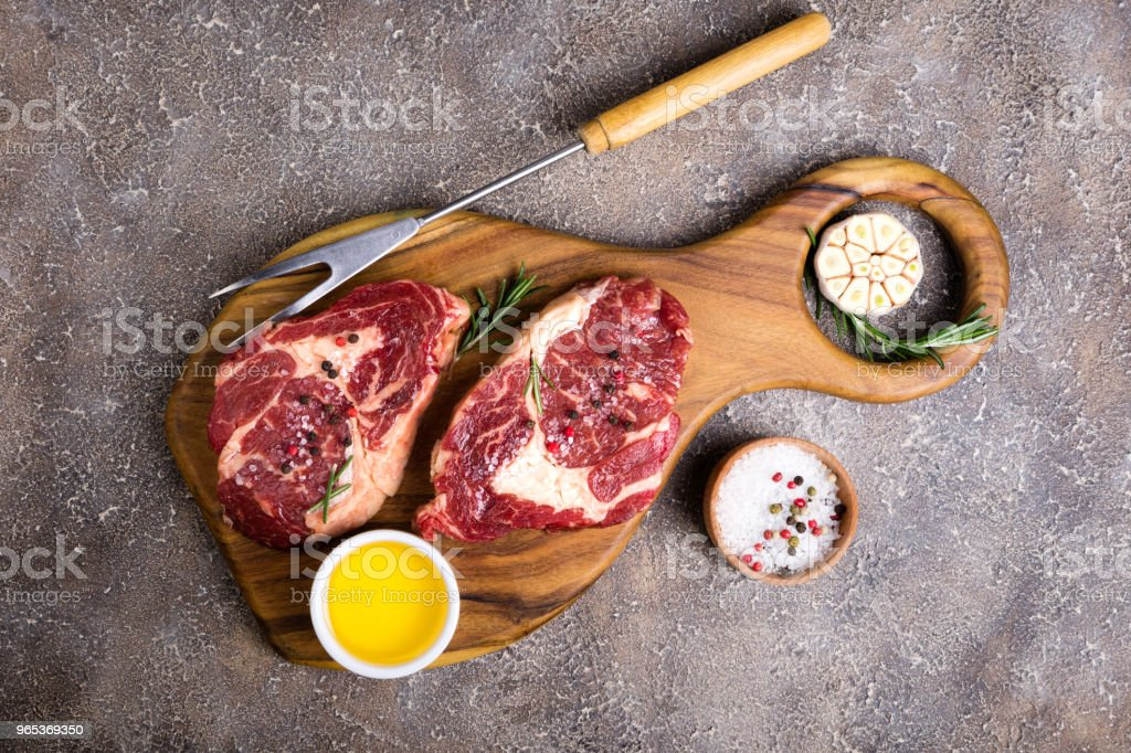 Raw beef steak and ingredients on cutting board. Raw meat zbiór zdjęć royalty-free