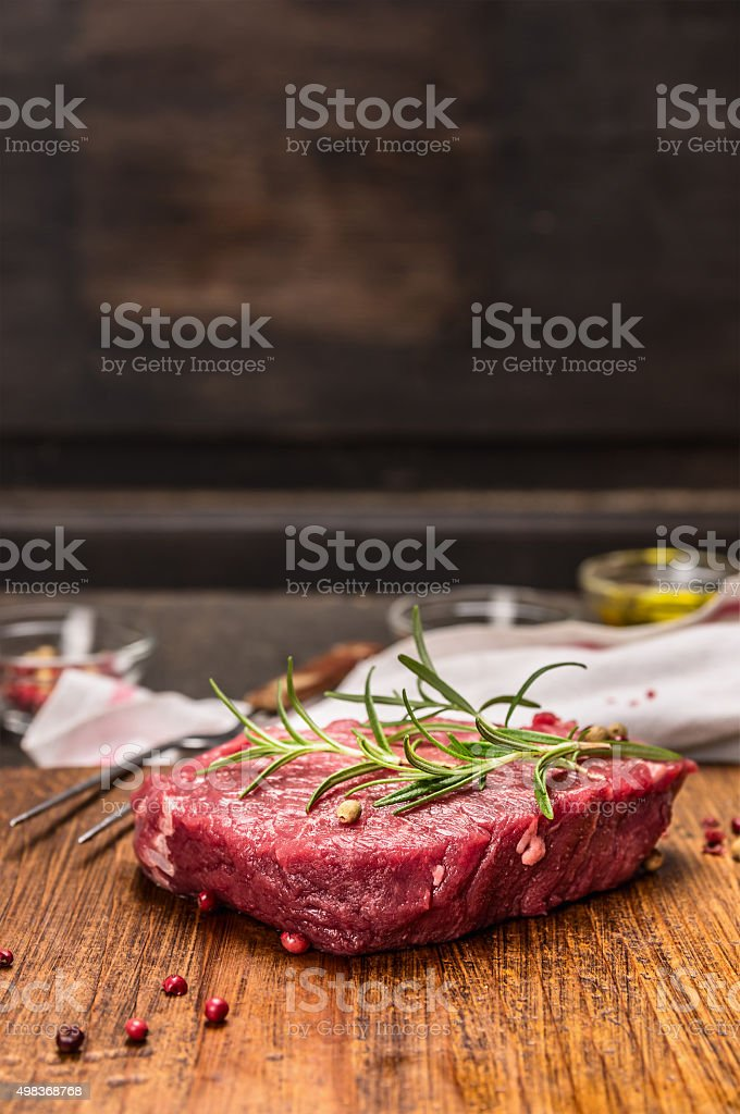 Raw beef steak ingredients for cooking rustic kitcen table stock photo
