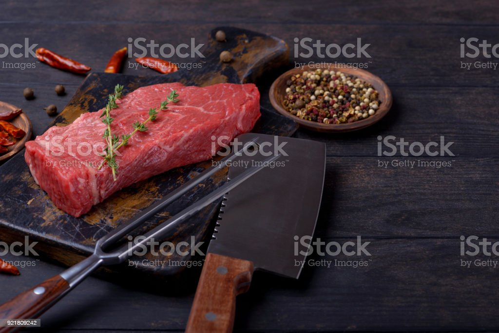 Raw beef steak meat and knife and fork stock photo