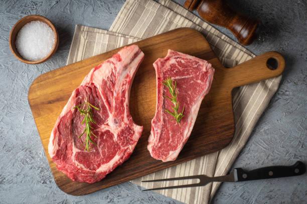 raw beef steak, new york strip steak and ribeye stock photo