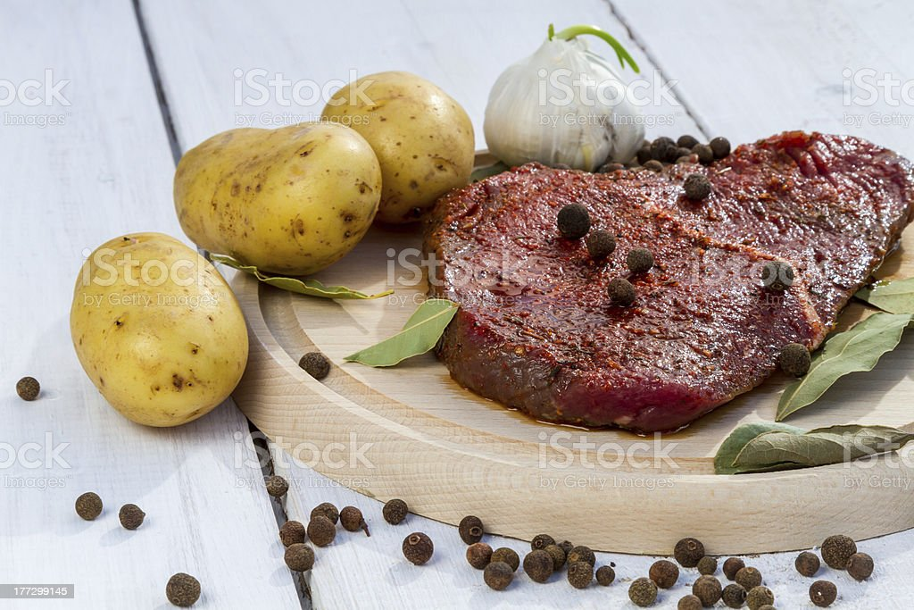 Raw beef steak with vegetables royalty-free stock photo