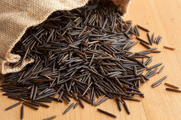 Raw black wild rice stock photo