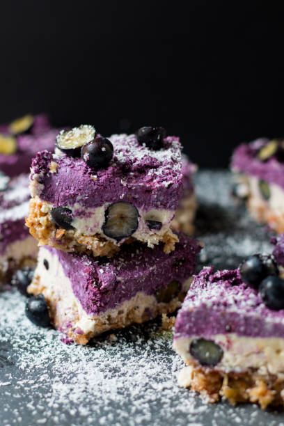 raw blueberry cheesecake - blueberry pie stock photos and pictures