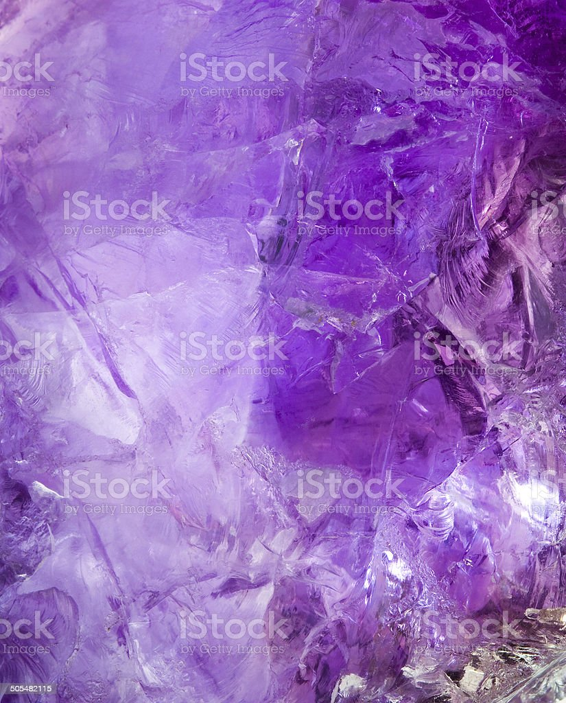 Raw Brazilian amethyst rock texture. stock photo