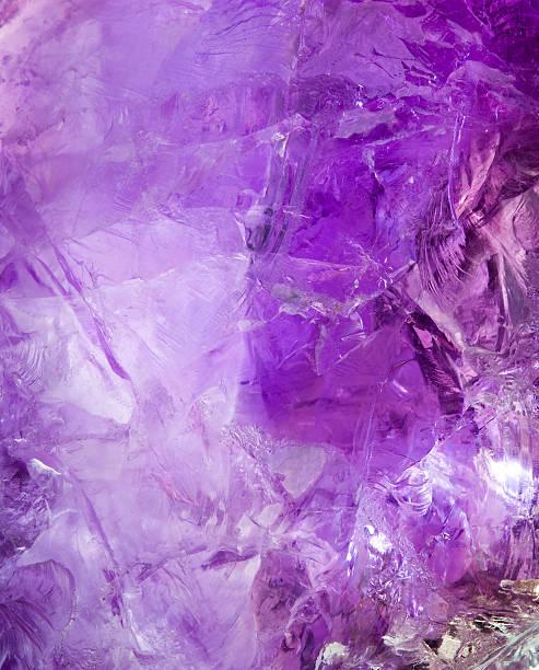 Raw Brazilian amethyst rock texture. stock photo