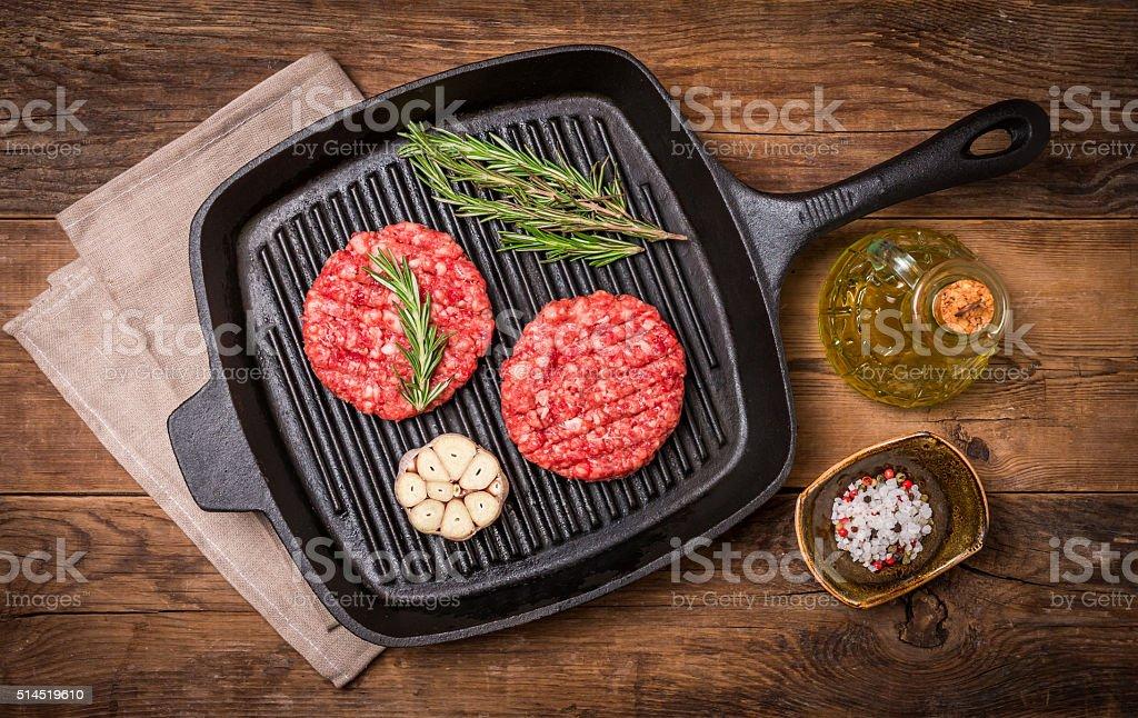 raw burgers from organic beef stock photo