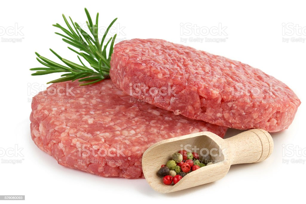 raw burgers, herb and spice stock photo