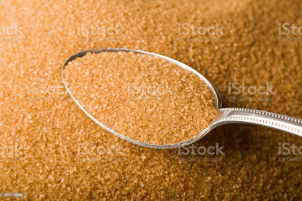 Raw cane sugar stock photo