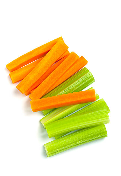 raw carrot and celery sticks raw carrot and celery sticks on white background celery stock pictures, royalty-free photos & images