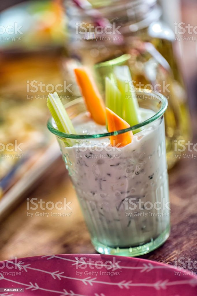 Raw Carrots and Celery Sticks with a Dip stock photo