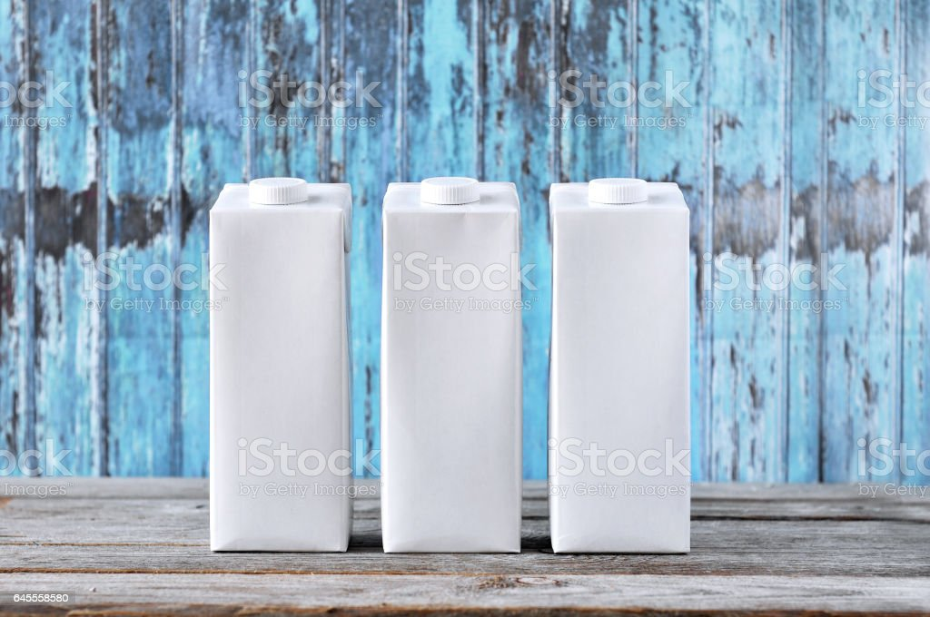 Raw carton package without pattern on a blue background. stock photo