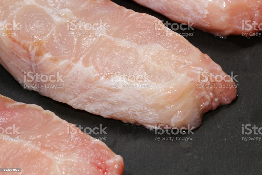 Raw Catfish steaks on a grey stone background, selective focus. stock photo