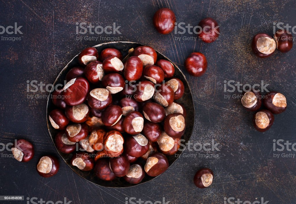 raw chesnuts stock photo