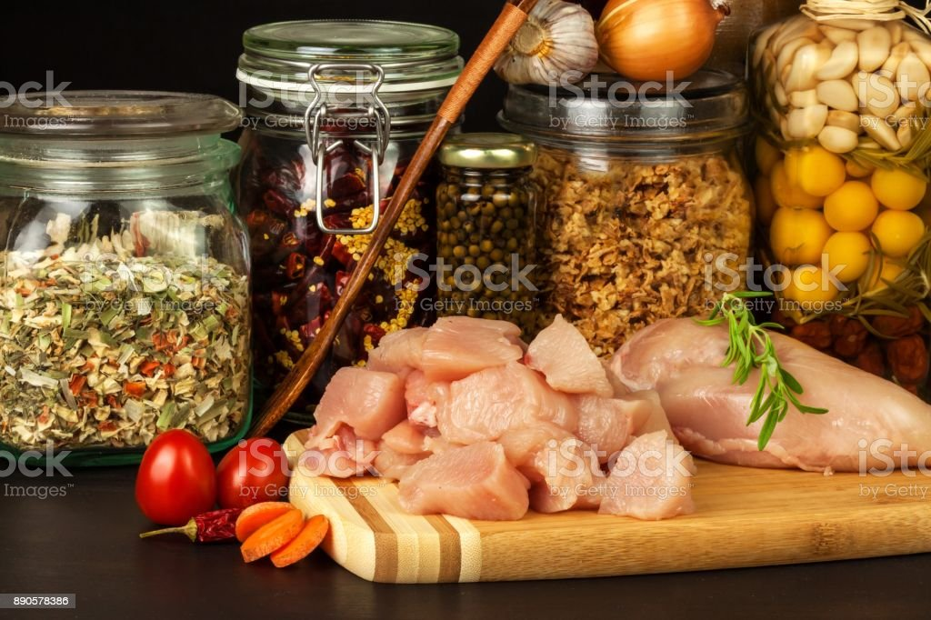 Raw chicken breast on the kitchen board. Diet food. Sale of meat....