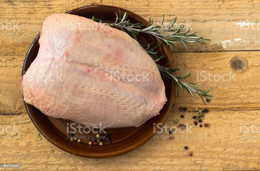 Raw chicken breast with skin stock photo