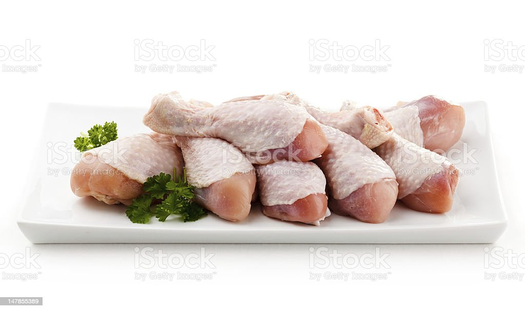 Raw chicken drumsticks on white background royalty-free stock photo