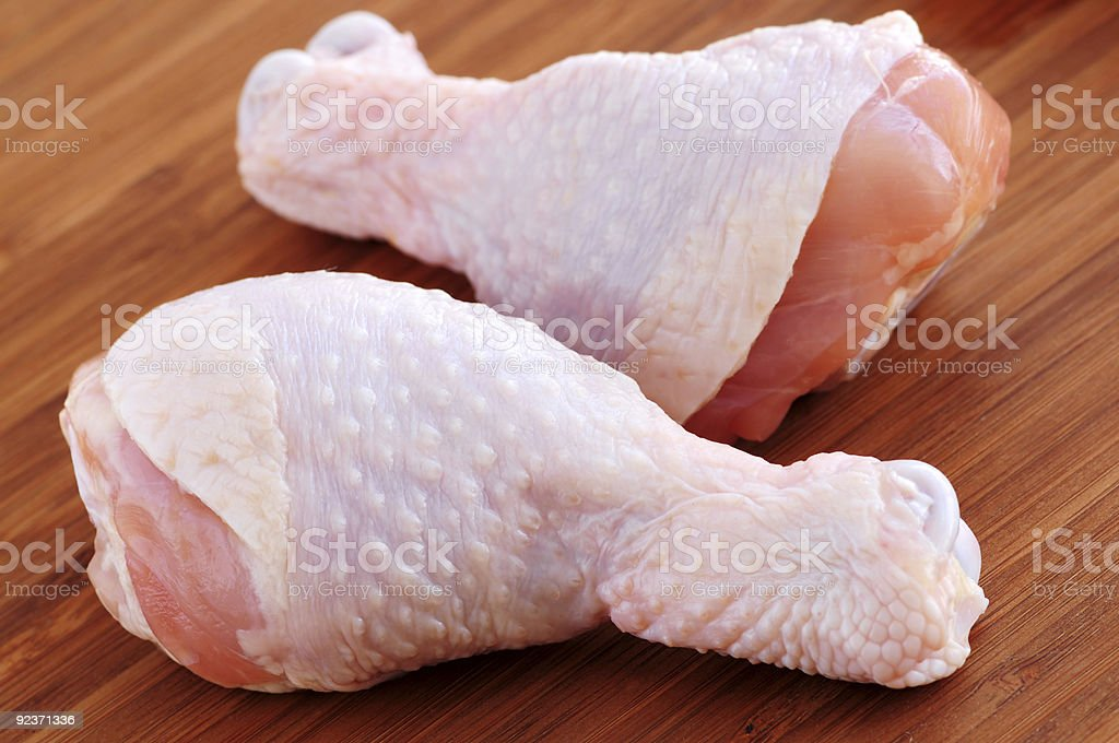 Raw chicken drumsticks royalty-free stock photo