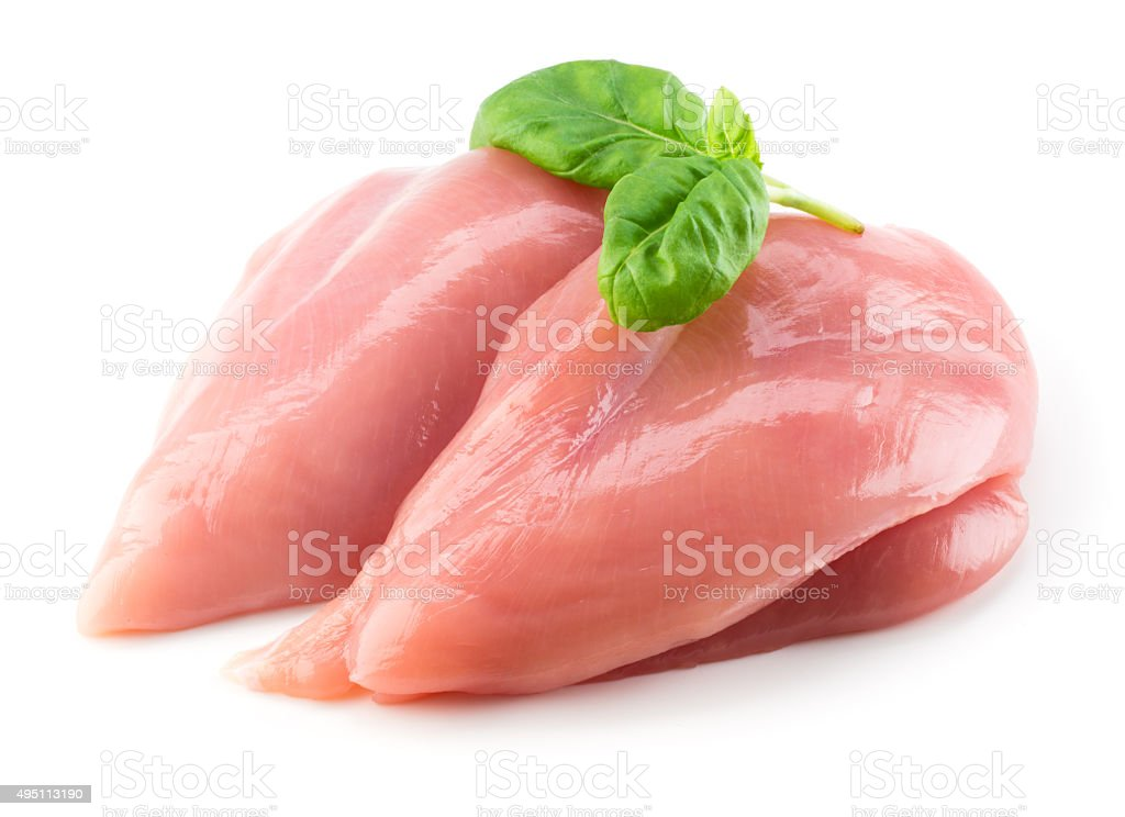 Raw chicken fillet with basil isolated on white stock photo