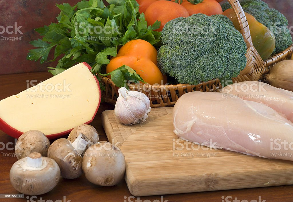 Raw chicken fillets, cheese and vegetables royalty-free stock photo