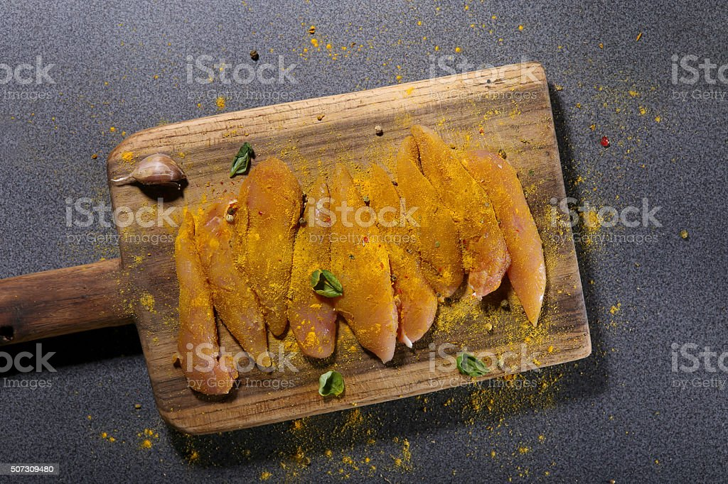 Raw chicken fillets with spices stock photo