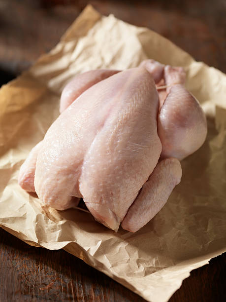 raw chicken in butchers paper - raw food stock photos and pictures