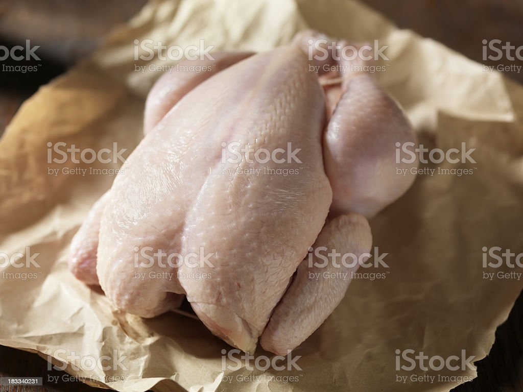 Raw Chicken in Butchers Paper stock photo
