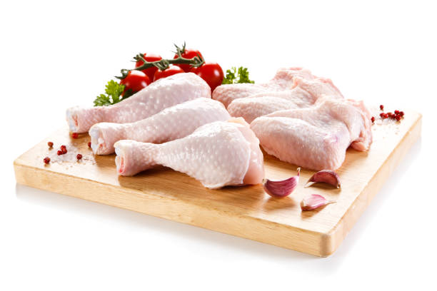 Raw chicken legs and wings on cutting board Fresh raw chicken drumsticks and wings drumstick stock pictures, royalty-free photos & images