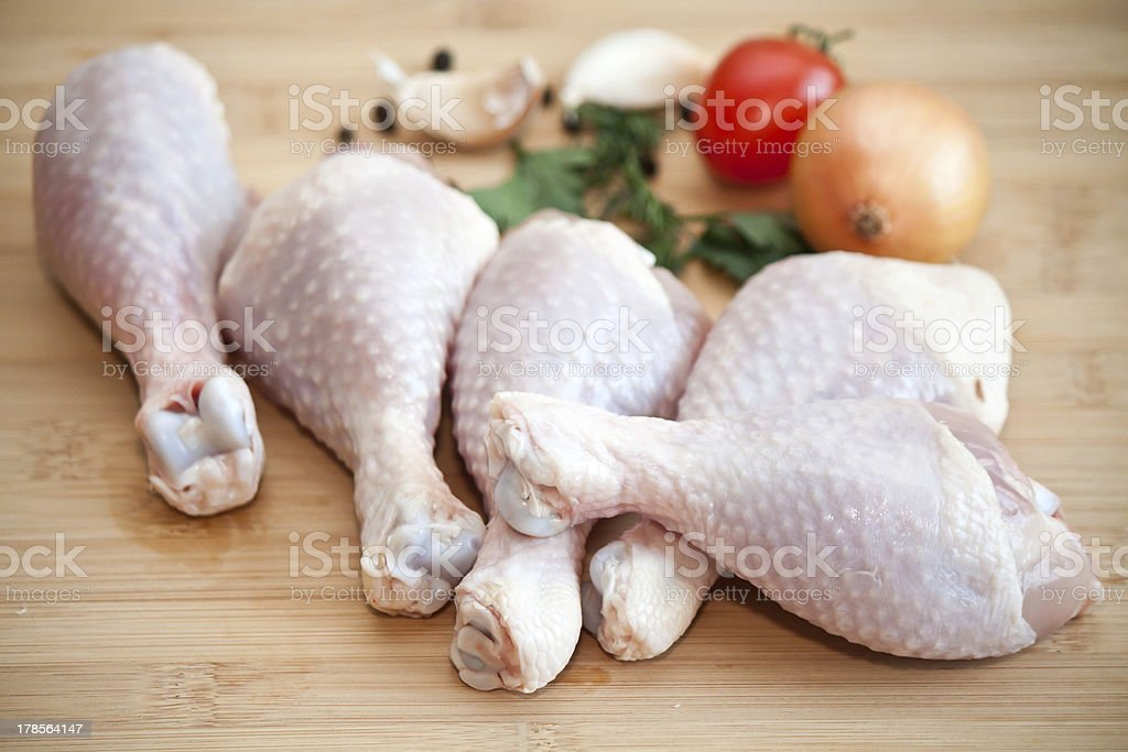 Raw chicken legs with vegetables and spices royalty-free stock photo