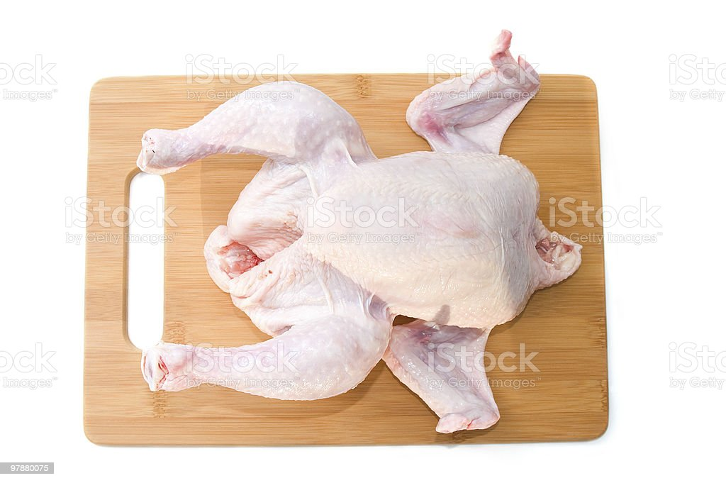 Raw chicken on wooden board royalty-free stock photo