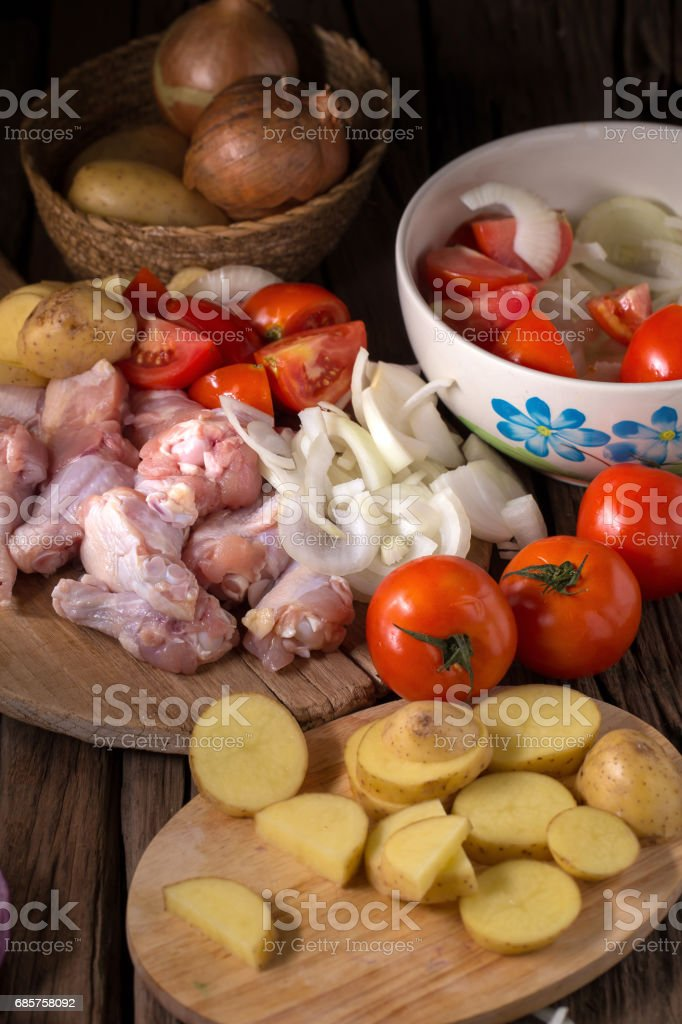 Raw chicken wings and ingredients for cooking on wooden background foto stock royalty-free