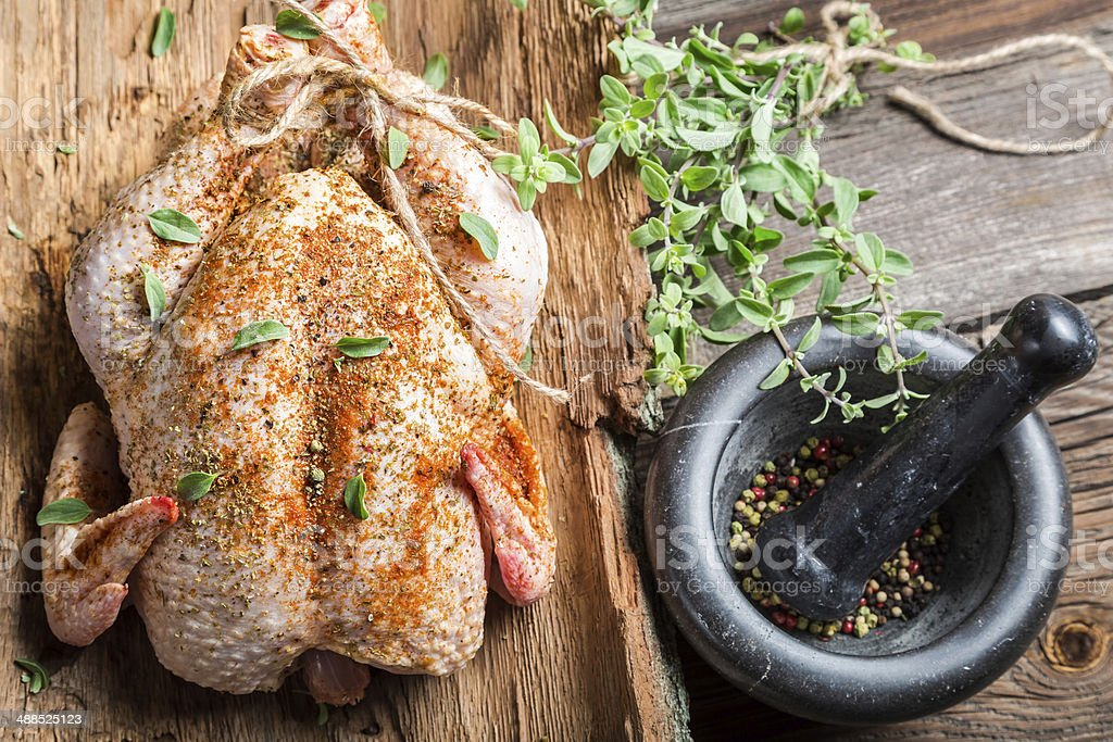 Raw chicken with herbs ready to cook stock photo