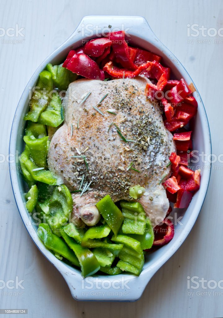 raw chicken with raw peppers stock photo