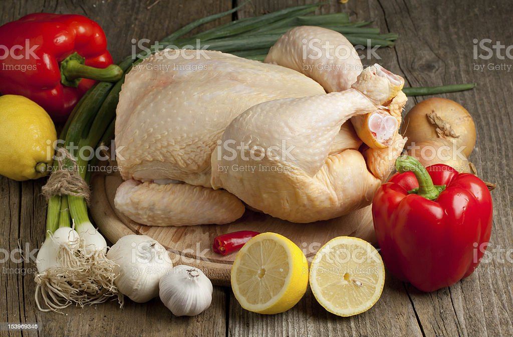 Raw chicken with vegetables royalty-free stock photo