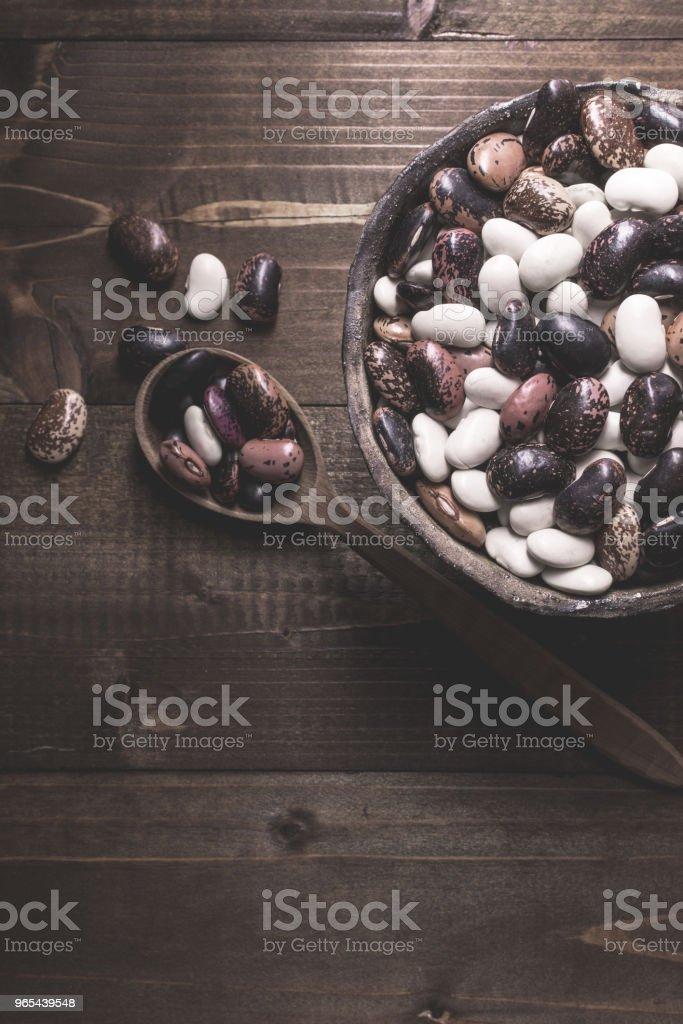 Raw Colorful Beans on Dark Wooden Background zbiór zdjęć royalty-free