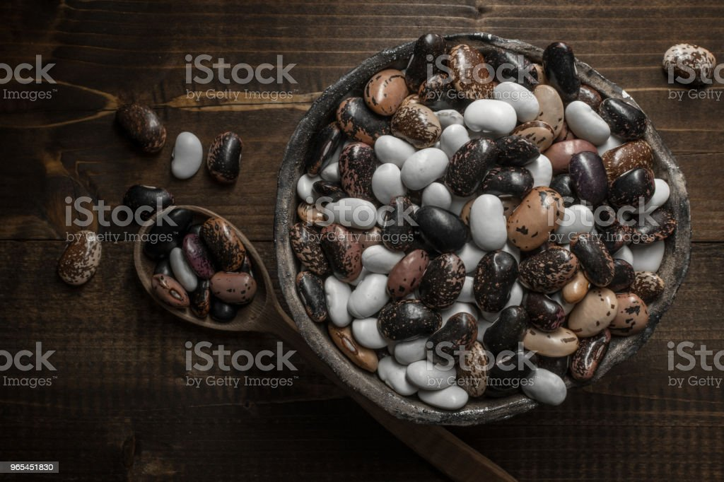 Raw Colorful Beans on Dark Wooden Background royalty-free stock photo