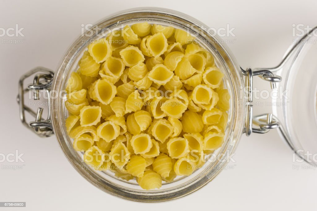 raw conchiglie  pasta noodles royalty-free stock photo