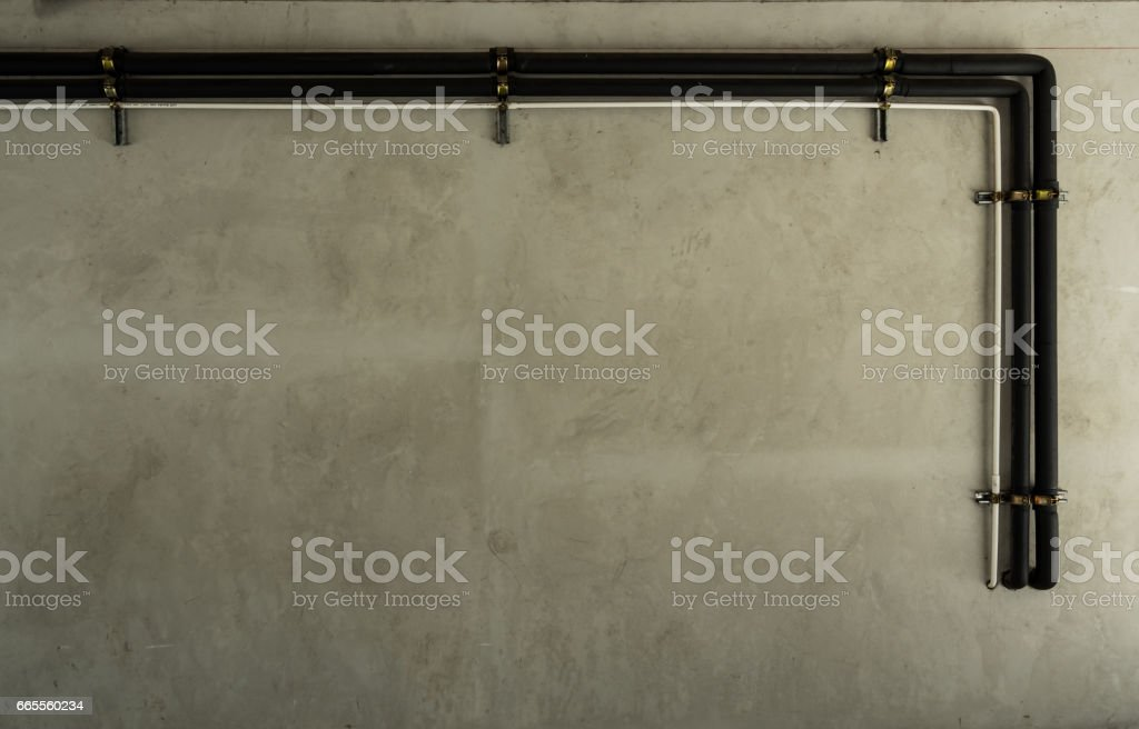 Raw concrete wall with air condition pipe system stock photo