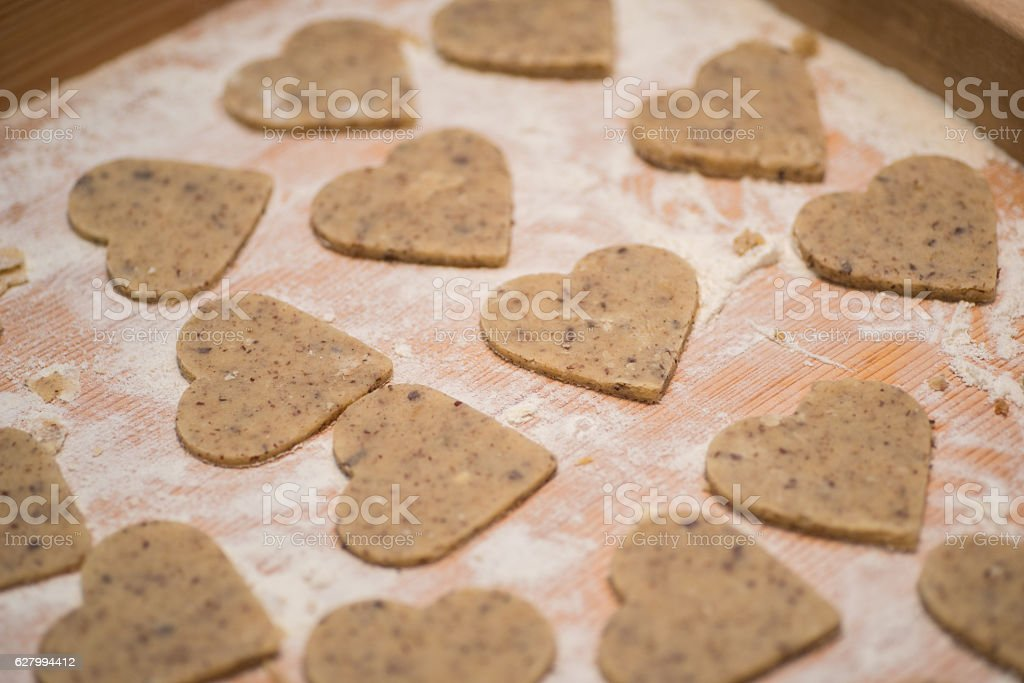 raw cookies in heart shape stock photo