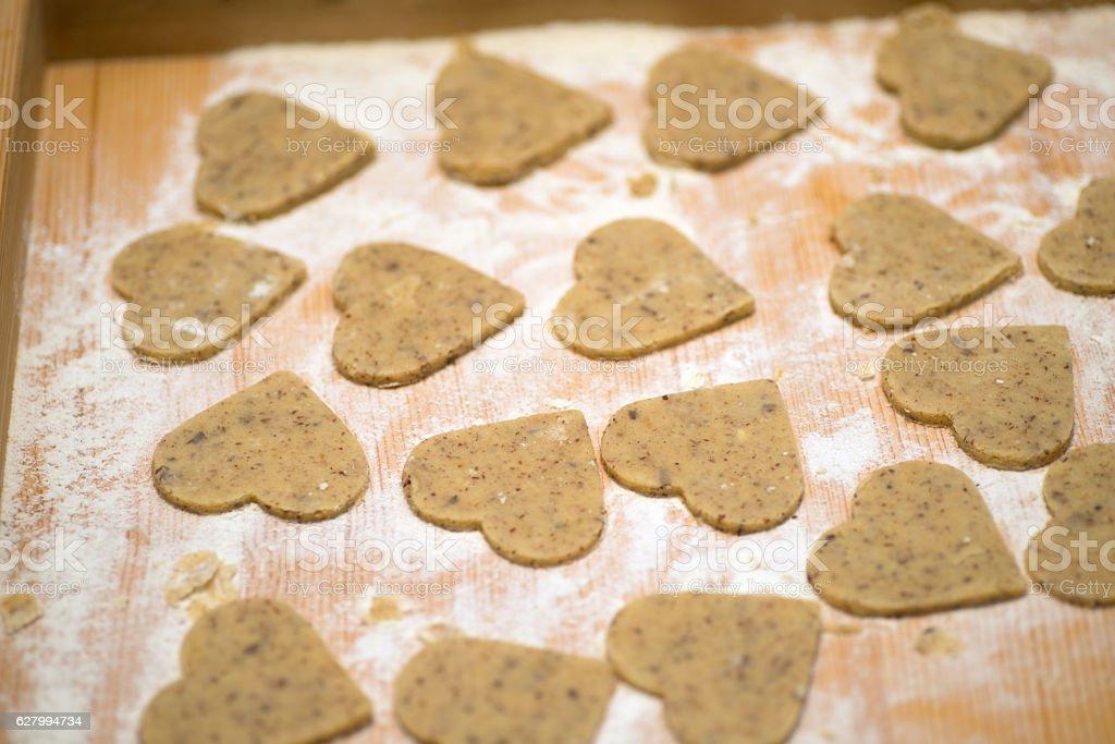 raw cookies in heartshape stock photo