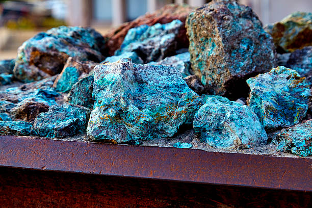 Raw Copper Ore Chunks of copper ore mineral rocks in an iron barrel mineral stock pictures, royalty-free photos & images