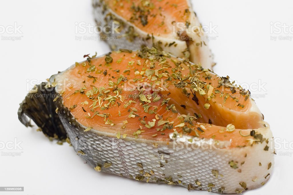Raw delicate salmon in herbs marinade prepared for cooking royalty-free stock photo