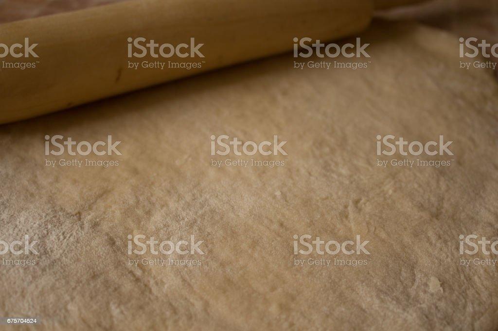 Raw dough flour rolling pin royalty-free stock photo