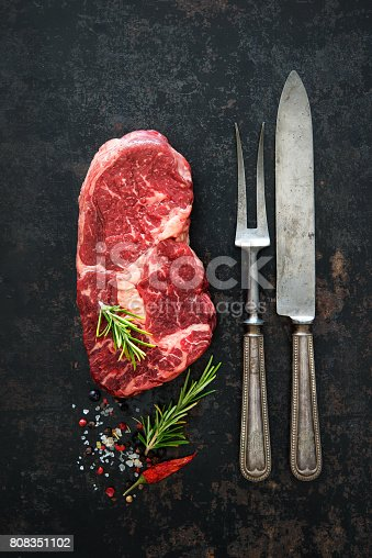 808351094istockphoto Raw dry aged beef ribeye steak 808351102