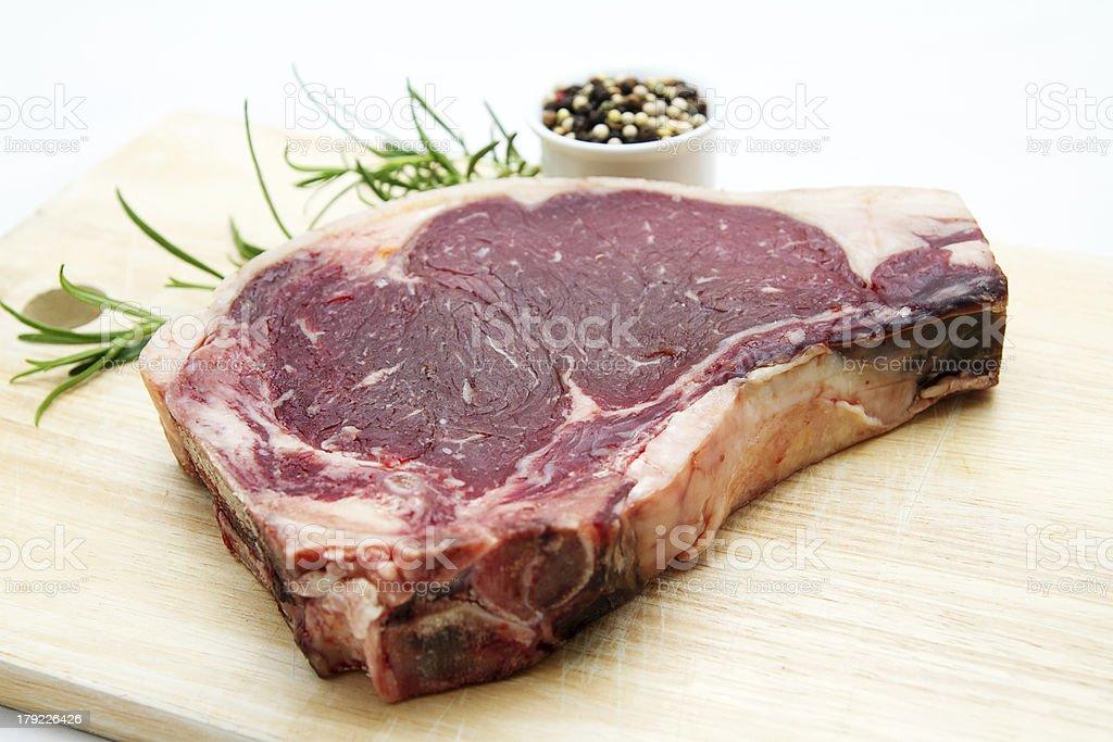 Raw dry aged t-bone steak royalty-free stock photo