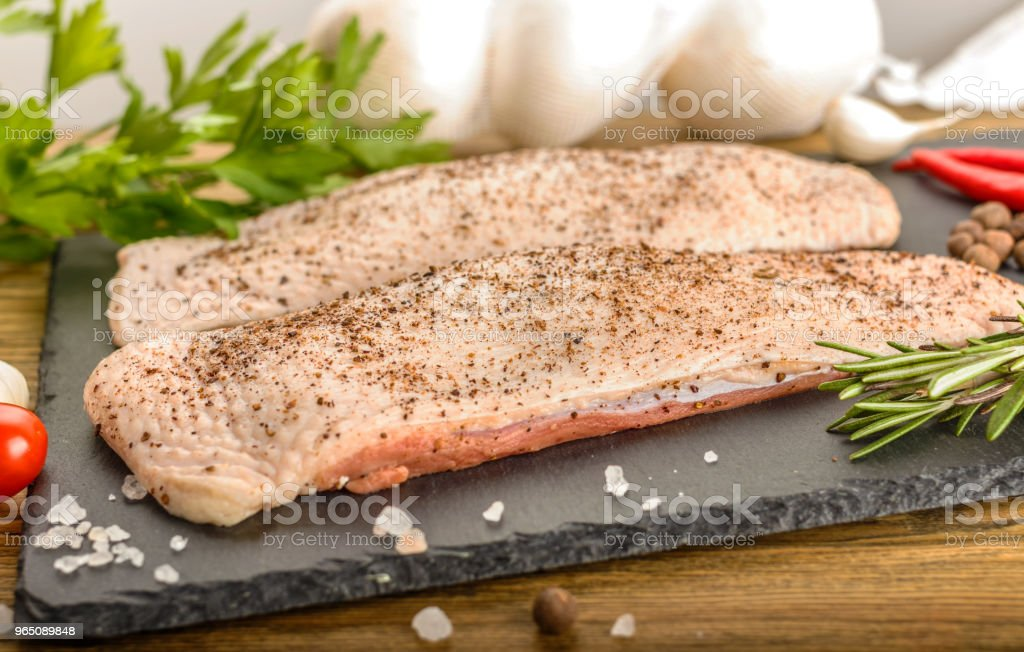 Raw duck breast. All for cooking a culinary delicacy. Creative mess on the kitchen table. zbiór zdjęć royalty-free