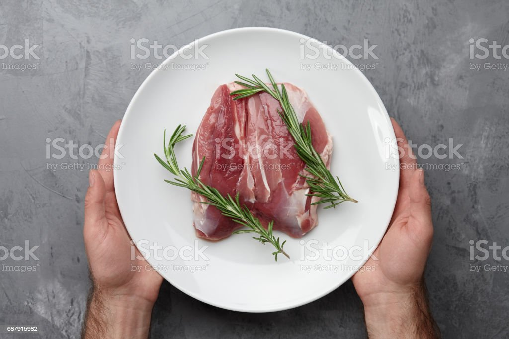 Raw duck breast in white plate stock photo