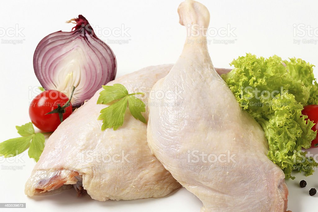 raw duck legs with vegetables royalty-free stock photo