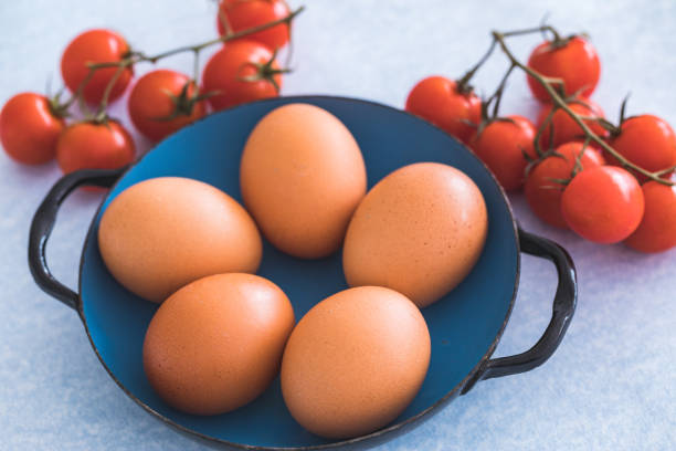 Raw eggs in metal plate stock photo